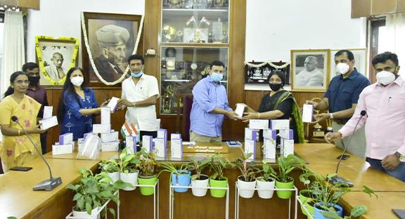 Revathy Ashok handed over scanners to Gautham Kumar, BBMP Mayor