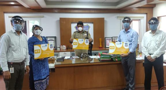 Revathy Ashok handed over face shields to Bhaskar Rao, Commissioner of Police